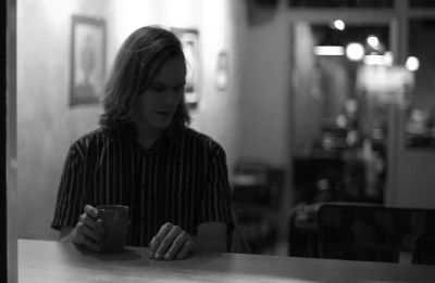 Matthew Hope Sitting At a Counter with Coffee